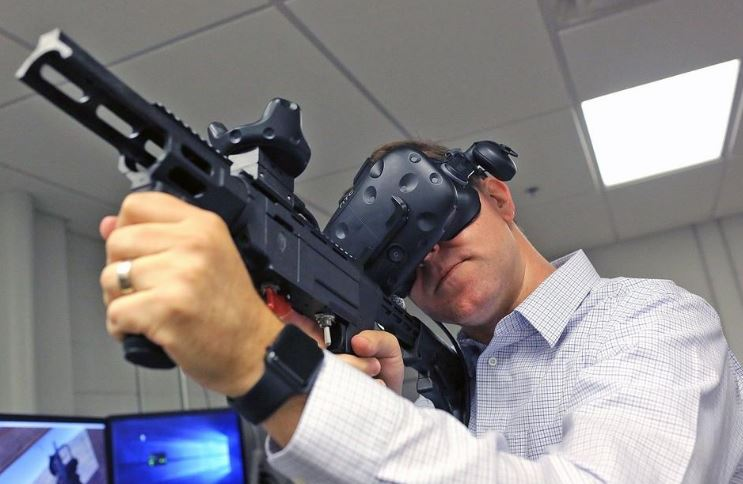Alex Morrow, technical director for counter unmanned aerial systems at Battelle, demonstrates a virtual reality tool used by the military